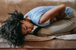 black woman with stomach pain