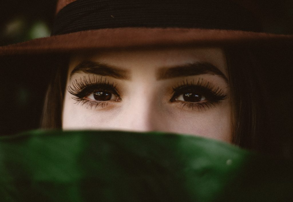 girl hiding behind leaf